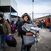 """Ahmed, 16, a Kurdish boy with a sweet demeanor from Aleppo, Syria, arrived at the Tabanovce Train Station in Macedonia before crossing the border into Serbia. Having escaped the war in his home country, Ahmed is traveling alone to try to meet his two brothers in Germany. He said he was traveling solo because, """"The route is too difficult for my mother, she would not be able to make it."""" Refugees traveling alone are common, because it is often too costly for entire families to make the journey—particularly for those who have lost so much in the war. For example, the perilous 4.1 mile dingy ride From Turkey to Greece is on average $2,000. Produced for Mercy Corps."""