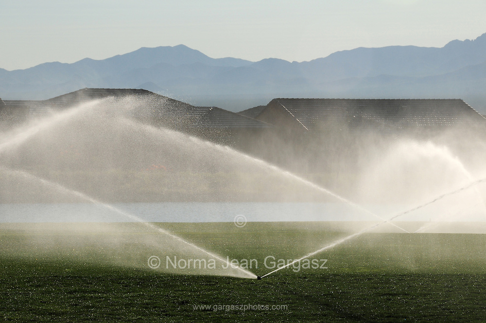 Reclaimed water is used to irrigate a golf course in the foothills of the Santa Rita Mountains of the Coronado National Forest in the Sonoran Desert, Green Valley, Arizona, USA.