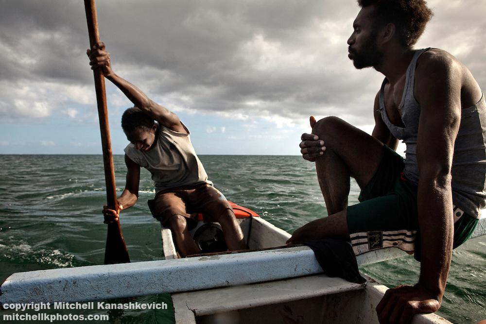 Ni Vanuatu fishermen in a canoe. Uleveo, Maskelyne Island, Malampa Province, Malekula, Vanuatu