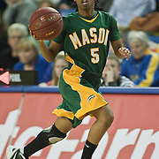 George Mason Guard Taleia Moton (5) brings the ball up court in the second half of an NCAA college basketball game against Delaware Thursday, Feb. 23, 2012, at the Bob Carpenter Center in Newark, Del. (AP Photo/Saquan Stimpson)