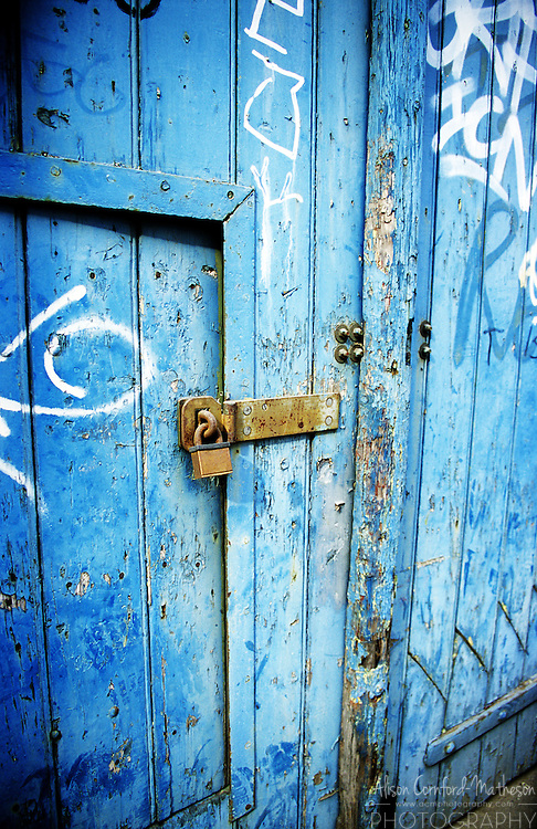 A lock on a blue warehouse door