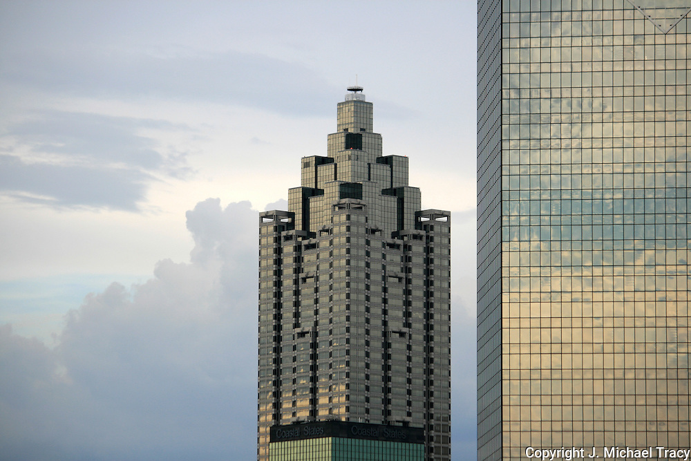 Two glass covered Atlanta skyscrapers reflecting summer stormy skies.