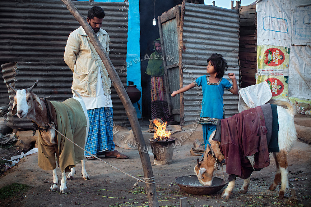 In the early morning, a family is starting the day by warming near a small fire in front of their homes by the railway tracks in New Arif Nagar, one of the water-affected colonies standing next to the abandoned Union Carbide (now DOW Chemical) industrial complex, site of the infamous 1984 gas tragedy in Bhopal, Madhya Pradesh, central India. The poisonous cloud that enveloped Bhopal left everlasting consequences that today continue to consume people's lives.
