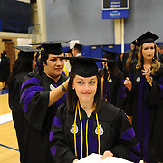 Law students put the finishing touches on their attire in the gymnasium of The Martin Centre.
