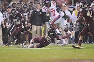 Ole Miss' Tobias Singleton (7) vs. Mississippi State kicker Derek DePasquale (40) in Starkville, Miss. on Saturday, November 26, 2011.