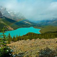 A rainbow hangs over Peyto Lake, Alberta, Canada