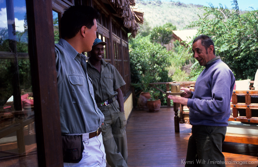 Africa, Kenya, Maasai Mara, Olanana. Olanana Camp guides sharing tales