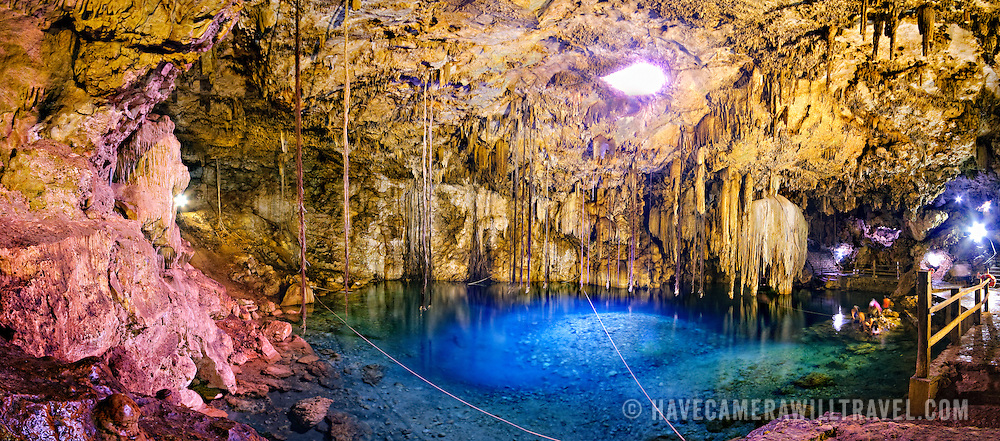 Panorama of Cenote Xkeken at Dzitnup, a scenic sinkhole near Valladolid, Yucatan, Mexico, that is now a popular swimming spot.