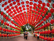 25 JANUARY 2017 - BANGKOK, THAILAND:        The entrance to a Chinese cultural exhibit during Chinese New Year, also called Tet, celebrations in Lumpini Park in Bangkok. 2017 is the Year of the Rooster in the Chinese zodiac. This year's Lunar New Year festivities in Bangkok were toned down because many people are still mourning the death Bhumibol Adulyadej, the Late King of Thailand, who died on Oct 13, 2016. PHOTO BY JACK KURTZ