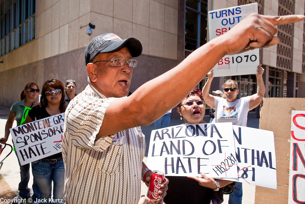 09 MAY 2011 - PHOENIX, AZ: MANUEL MARTINEZ, an immigrants' rights supporter, shouts at opponents of illegal immigration at the Arizona State Capitol in Phoenix Monday. Governor Jan Brewer, State Senate President Russell Pearce and Attorney General Tom Horne, all Republicans, held one press conference to announce that the state was suing to take its legal battle over SB1070, Arizona's tough anti-immigration law, past the US Court of Appeals and straight to the US Supreme Court. State Senator Steve Gallardo, a Democrat, held a press conference to announce that he was opposed to the Republican's legal actions and called on them to drop the suit altogether. Isolated shouting matches broke out between activists on both sides of the immigration issue during the press conferences.       Photo by Jack Kurtz