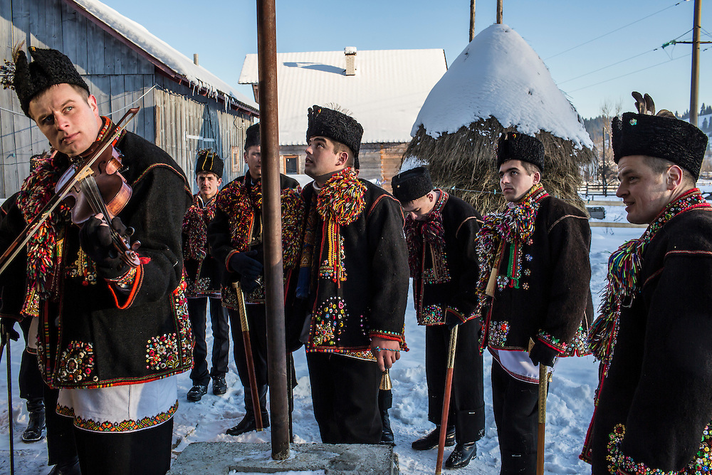 ILTSI, UKRAINE - JANUARY 7: Men wearing traditional Hutsul clothing sing for local residents in celebration of Orthodox Christmas on January 7, 2015 in Iltsi, Ukraine. The men gather in groups and travel house to house for twelve days singing songs until they've visited every home in the village. (Photo by Brendan Hoffman/Getty Images) *** Local Caption ***