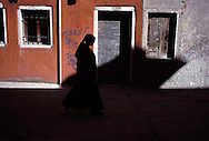 A nun walks through the streets of Venice, Italy on Good Friday, March 29, 2002.