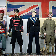 Mannequins dressed with British, American, Moroccan and french uniforms of WWI under the Union Jack at the the Somme Trench Museum in Albert (‪Musée Somme 1916‬)The museum is in the old crypts under the basilica of Albert and shows scenes of trench life from WWI, original uniforms, war paraphernalia  and other items rescued from the fields.
