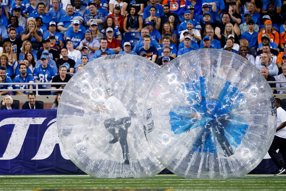 Tim Horton's human ball race during a time out of an NFL football game between the Detroit Lions and the Denver Broncos at Ford Field in Detroit, Sunday, Sept. 27, 2015. (AP Photo/Rick Osentoski)