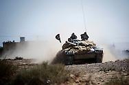 LIBYAN ARAB JAMAHIRIYA, Um al Far : A rebel tank moves through Um al Far after heavy fighting to take control of the village, on July 28, 2011. ALESSIO ROMENZI