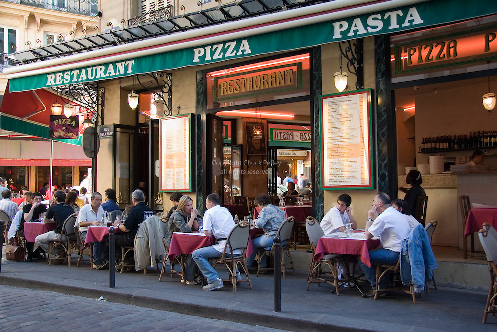 People Dining At Sidewalk Tables At A Pizza And Pasta Restaurant On Rue De La Harpe Near Place