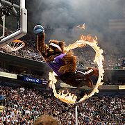 The Utah Jazz's mascot Bear does a stunt during a time out during play against the Houston Rockets in game four of the first round of the NBA playoffs at the Energy Solutions Arena in Salt Lake City, Utah Saturday April 26, 2008. August MIller/ Deseret Morning News .