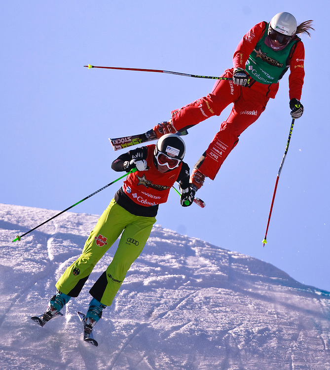 IMG_1199.CR2 -20110211- Collingwood, Ontario,Canada -- Heidi Zacher of Germany and Katrin Mueller of Switzerland catch some air during their quarter final race at the Rockstar Ski Cross Grand Prix event at Blue Mountain in Collingwood, Ontario, February 11, 2011.<br /> AFP PHOTO/Geoff Robins