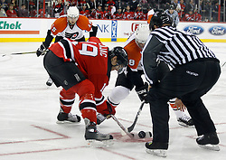 November 8, 2007; Newark, NJ, USA;  New Jersey Devils center Travis Zajac (19) faces off against Philadelphia Flyers center Daniel Briere (48) during the first period at the Prudential Center in Newark, NJ.