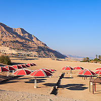 Judean Desert hills are the backdrop for the public beach at Ein Gedi on the western Dead Sea coast. WATERMARKS WILL NOT APPEAR ON PRINTS OR LICENSED IMAGES.