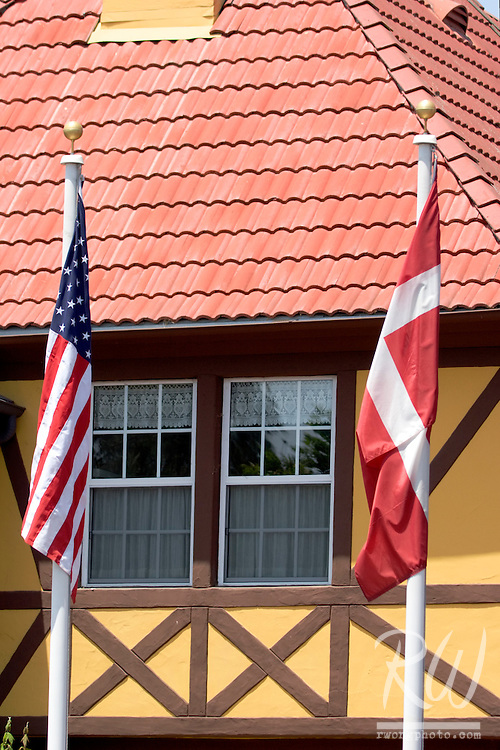 U.S. and Denmark Flags Hanging in Front of Danish Half-Timbered Houses, Solvang, California