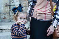 A blue eyed girl with her mom in the Mea Sharim neighborhood of Jerusalem