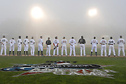 Players line up for the national anthem during Eastern League All-Star baseball game in Norwich, Conn.  The game was called due to fog after 2 1/2 innings.