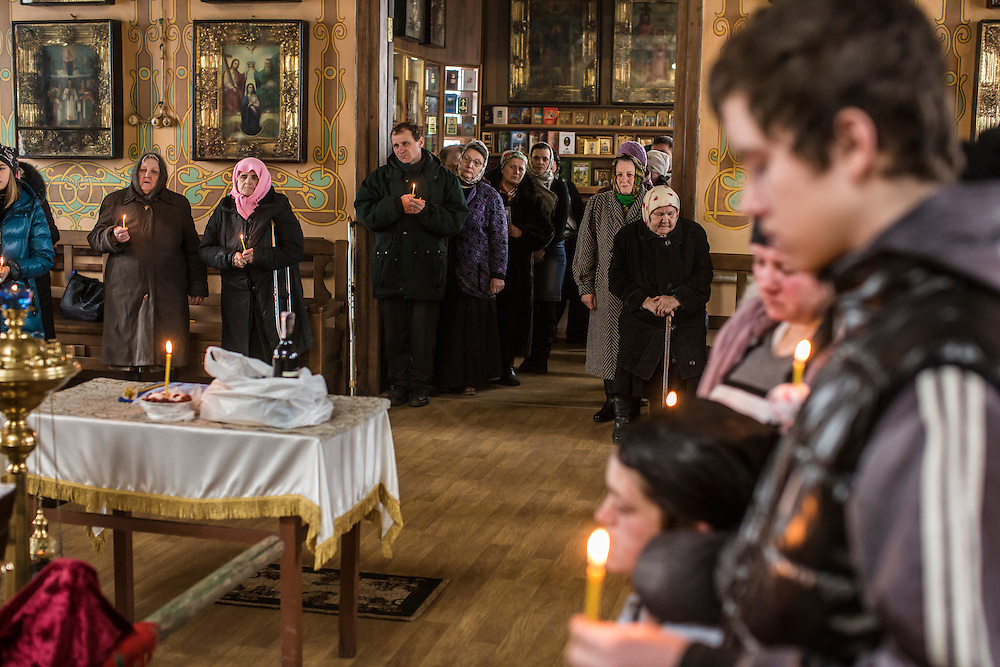 ARTEMIVSK, UKRAINE - FEBRUARY 15: Family and friends attend the funeral of Igor Molodetskykh, 7, who was killed two days prior when a shell hit his school on February 15, 2015 in Artemivsk, Ukraine. A ceasefire scheduled to go into effect at midnight was reportedly observed along most of the front, save for near the embattled town of Debaltseve. (Photo by Brendan Hoffman/Getty Images) *** Local Caption *** Zhanna Molodetskykh