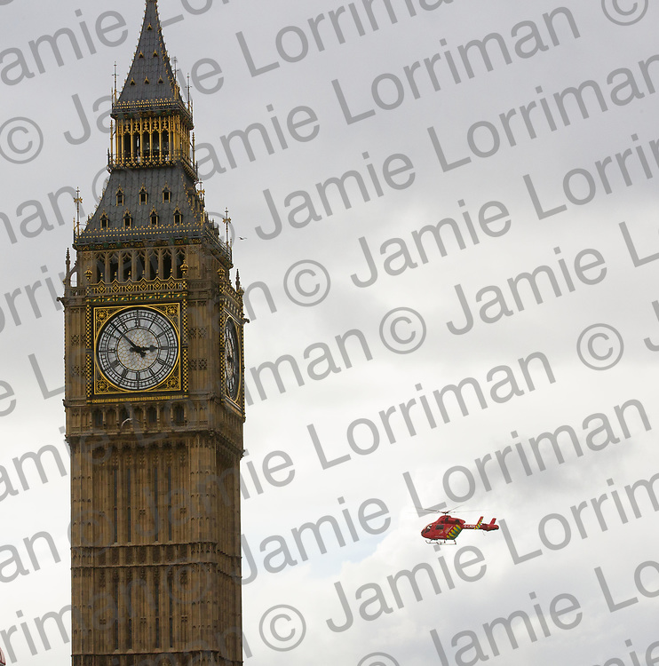 Terrorist incident on Westminster Bridge, London<br /> <br /> Pictured: The air ambulance lands in Parliament Square seen from Westminster Bridge, London<br /> <br /> Jamie Lorriman<br /> mail@jamielorriman.co.uk<br /> www.jamielorriman.co.uk<br /> 07718 900288