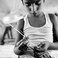 Moha Rafique found a twig and string and tries to figure out if he can make something out of it to play with. Having lost the few toys they had before the flood and no schooling in the camp, the children become very resourceful in ways to play and keeping occupied. Karachi, Pakistan, 2010