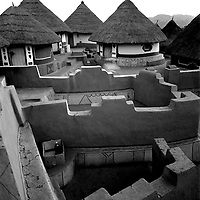 The intricate maze of walls demarcates each familyÕs courtyard in the sacred village of Shongwezi in the mountains above Louis Trichardt, Limpopo Province South Africa, July1989. The Mphephu royalty are buried in a sacred grove here, and the village exists to protect and serve the spirits of the ancestors. Greg Marinovich