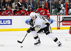 Dec 10, 2008; Newark, NJ, USA; Pittsburgh Penguins center Sidney Crosby (87) skates with the puck during the first period of their game against the New Jersey Devils at the Prudential Center.