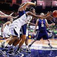 SOUTH BEND, IN - MARCH 04: Markisha Wright #34 of the Notre Dame Fighting Irish reaches for a loose ball as Stefanie Dolson #31 of the Connecticut Huskies looks on at Purcel Pavilion on March 4, 2013 in South Bend, Indiana. (Photo by Michael Hickey/Getty Images) *** Local Caption ***Markisha Wright; Stefanie Dolson