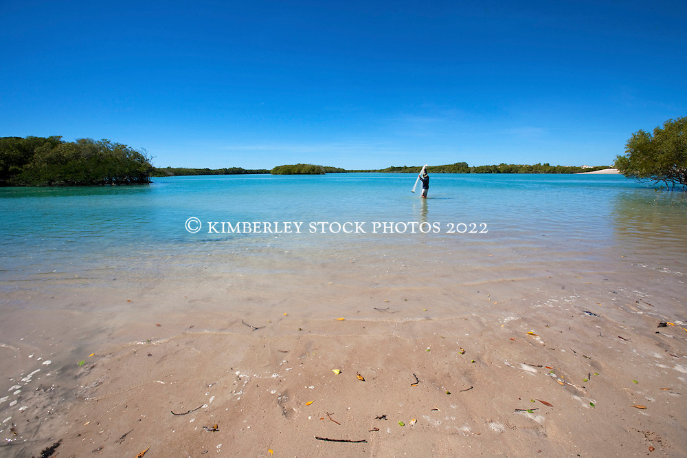 A local fisherman uses a thrownet to catch mullet as bait at Barred Creek on the Dampier Peninsular, norrth of Broome, a favourite fishing spot for locals.