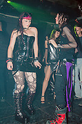 Israel, Tel Aviv, 2 young teens male and female Dancing at a nightclub