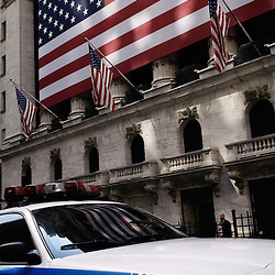 A police car parked in front of the New York Stock Exchange. Wandering  around the Financial District with the  Wall Street's Soundwalk (by John Solitto) on my ears. 2009, June 12th. Photo: Antoine Doyen