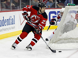 December 7, 2007; Newark, NJ, USA;  New Jersey Devils defenseman Mike Mottau (27) skates around his own goal during the 3rd period of the Devils game against the Washington Capitals at the Prudential Center in Newark, NJ.  The Devils won 3-2, their ninth win in a row.