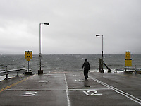 Man waiting for ferry in bad weather