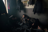 """Early morning. A group of Afghan stranded in Belgrade, Serbia. By the railway station in downtown Belgrade, the temporary citizens-from-nowhere are living their nomad existences in the the rubble of the so-called Belgrade """"Waterfront"""" construction project."""