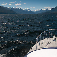 View from the deck of the the ferry across the black freshwater of Lake Te Anau, Fiordland, New Zealand. At 388 sq km and over 500m deep, it is the largest body of fresh water in Australasia and one of the biggest in the world by volume.