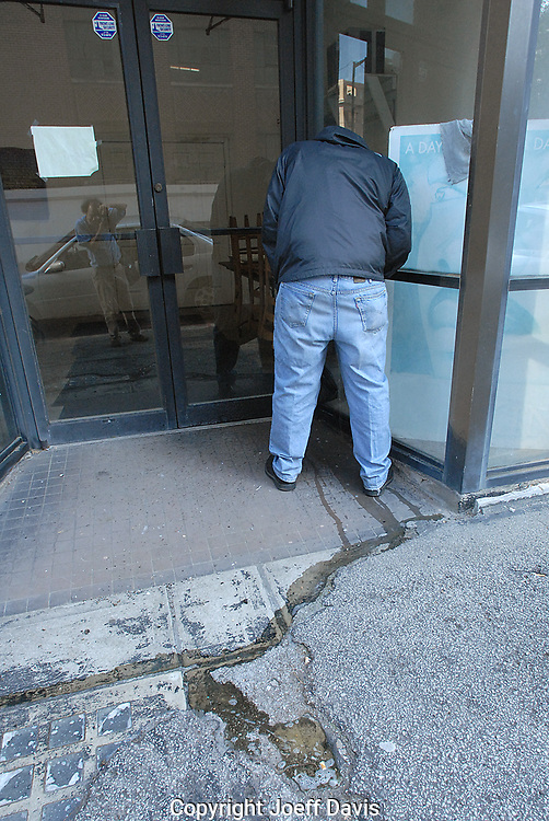 A man urinates in downtown Atlanta, Georgia.