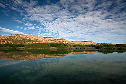 Clouds reflected in still water in Poulton Creek, Talbot Bay near the Horizontal Waterfalls.  A signicant volume of freshwater flows out of Poulton Creek in the Kimberley wet season, holding back the saltwater that flows in from Talbot Bay.