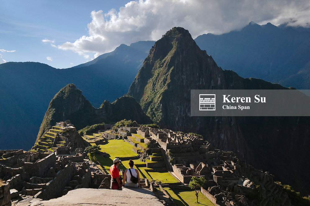 Traveler with ancient ruins of Machu Picchu in the Andes Mountain, Peru