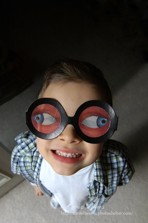 young boy wearing funny sun glasses
