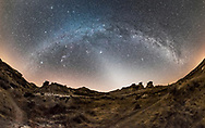 A 200+ degree panorama of the arch of the winter Milky Way, from south (left) to northwest (ar right) with the Zodiacal Light to the west at centre. This was from Dinosaur Provincial Park in southern Alberta on February 28, 2017. A spell of warm weather left very little snow, so the landscape does not look like winter here. But the sky is! <br /> <br /> This is a stitch of 6 segments but warped with fish-eye projection so that only 3 or 4 segments are contributing to this image. Stitched with PTGui. Each segment was 30 seconds at f/2.8 with the Rokinon 12mm lens and Nikon D750 at ISO 6400. Nik Dfine and Topaz noise reduction applied, in addition to ACR.