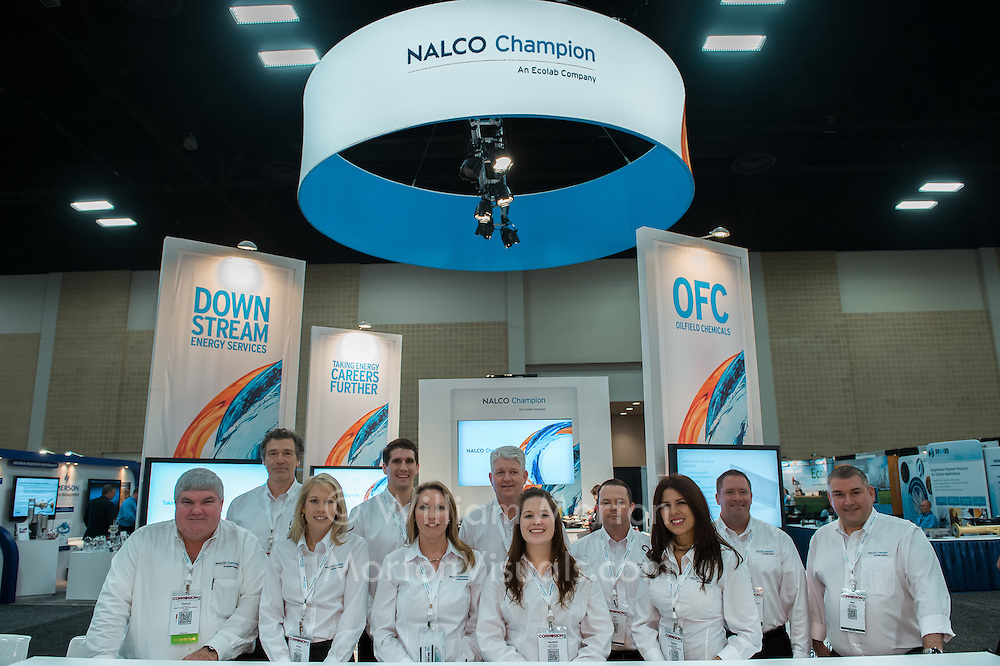 The Nalco Champion team mans their booth at the NACE convention trade show at the Henry B. Gonzalez Convention Center in San Antonio, TX. Photography by Dallas event photographer William Morton of Morton Visuals event photography.
