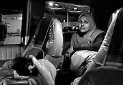 Relieved after crossing the border into the safety of Jordan, Hadia relaxes in the van as Marwa sleeps in the front seat. Now all that remains is to wait for visas and begin the journey to America where Hadia and the children will be reunited with Saleh and Raheem.