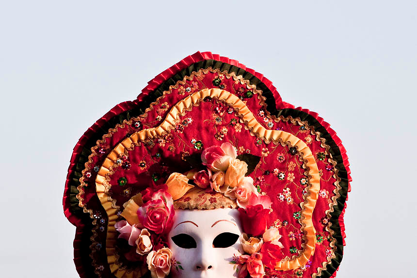 A masked reveller poses in Saint Mark's Square during the Venetian Carnival in Venice ...