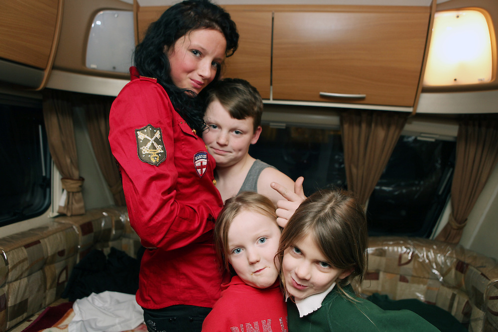 Irish Traveller Bridy Purcell and her family in their caravan on the site they live in Greenwich, February 2012