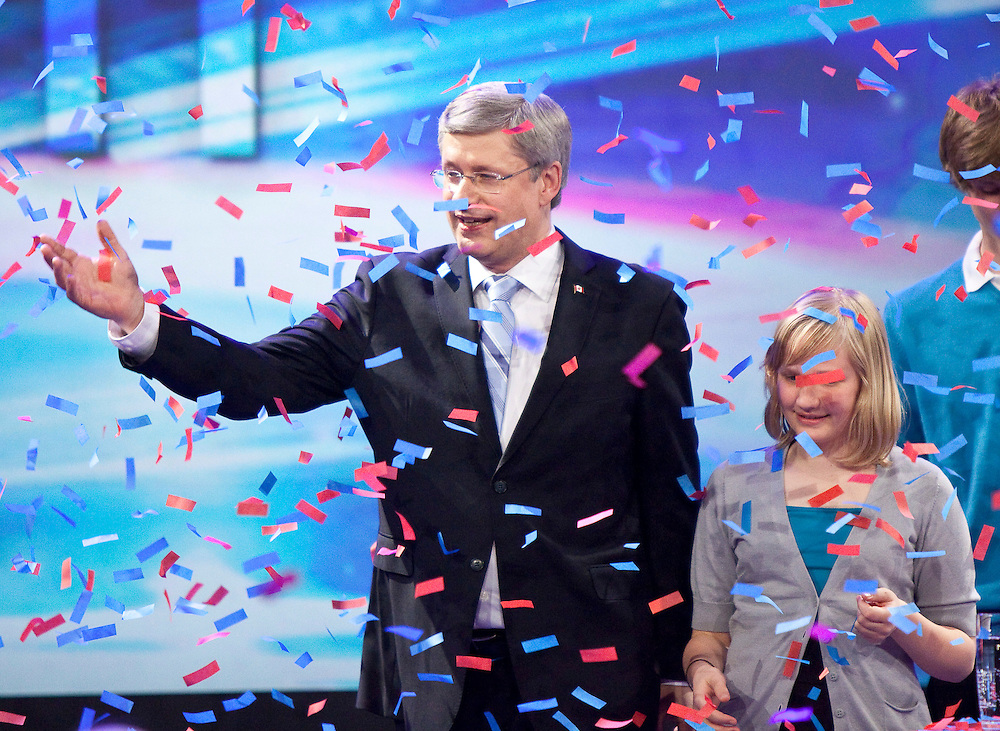 Conservative leader Stephen Harper celebrates a Conservative majority government and his daughter Rachel in Canada's federal election at the Telus Convention Centre in Calgary, Alberta, May 2, 2011.<br /> AFP/GEOFF ROBINS/STR